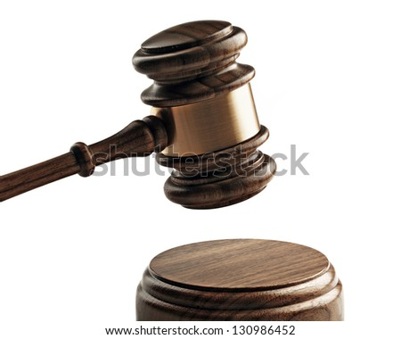 A wooden judge gavel and soundboard isolated on white background. - stock photo