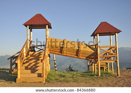 A wooden kid's playhouse on top of the hill - stock photo