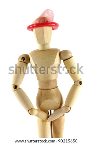 A wooden mannequin with condom on his head, conceptual photo of thinking with the right head - stock photo
