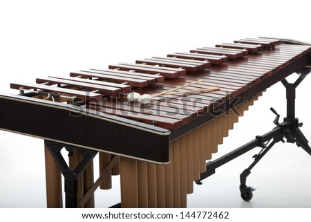 A wooden marimba and mallets on a white background - stock photo