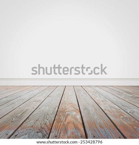 A wooden old floor and a blank white white background. Add your own text message to the empty area. - stock photo