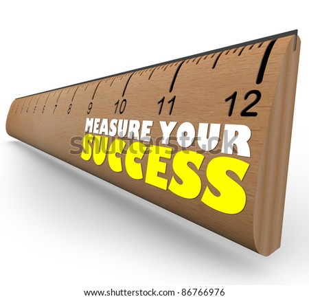 A wooden ruler with the words Measure Your Success, representing a review, evaluation or assessment of a worker, process or organization working toward a goal - stock photo