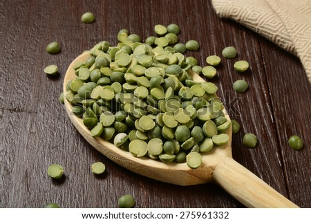 A wooden spoon full of dried split peas - stock photo