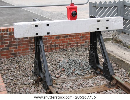 A Wooden Train Buffer at the End of a Railway Track. - stock photo