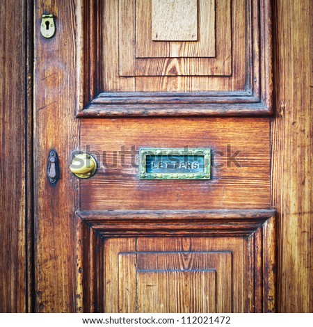 A wooden vintage front door with a letter box - stock photo