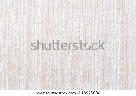 a woolen white and beige carpet, a closeup shot - stock photo