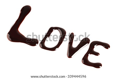 "A word ""love"" written with chocolate, isolated on white"