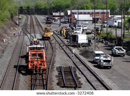 a work crew and equipment on the railroad