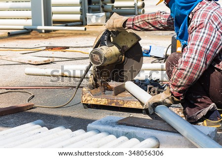 A worker have working by a steel cutter usage on holiday - stock photo