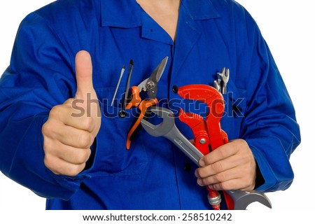 a worker in an industrial enterprise  with tools in hand - stock photo