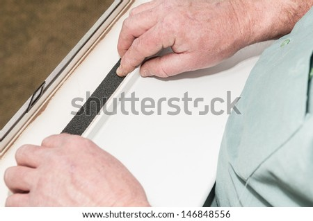 A worker installs insulation in window. - stock photo