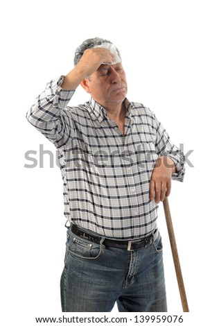 A worker wipes his sweat - stock photo