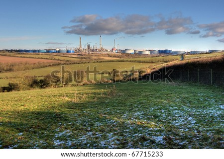 A working oil refinery in Pembrokeshire with snow in foreground