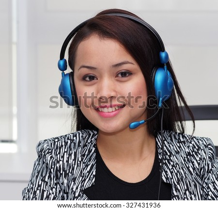 A working young lady with telephone - stock photo