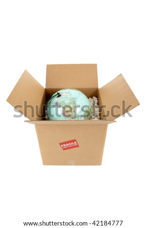 A world globe in a packing box with a fragile sticker on a white background