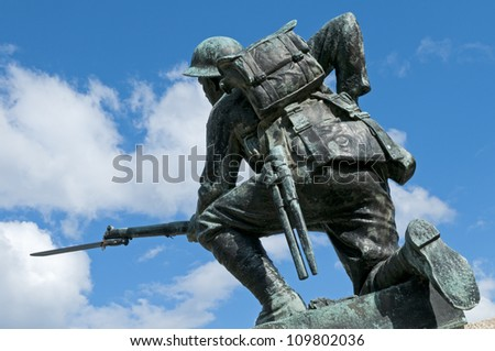 A World War I monument. The soldier is equipped with British Pattern 1908 webbing, a Short Magazine Lee-Enfield Mk III (SMLE) .303 rifle, and a Pattern 1907 sword bayonet. - stock photo