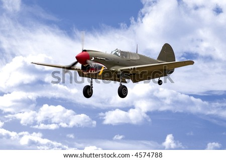 A World War Two U.S. Army Air Corps Curtiss P40 fighter aircraft landing. - stock photo