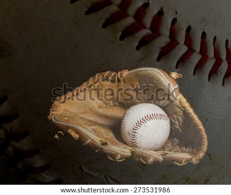 A worn baseball sits inside an old baseball glove with the leather and stiching of a ball in the background.  Image was lit by using a lightpainting technique.