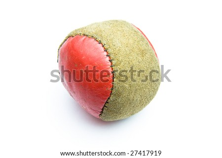 A worn hacky sac over a white background - stock photo