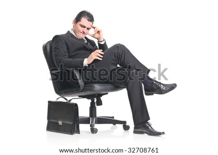 A worried businessman sitting in an office chair isolated on a white background