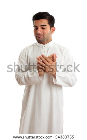 A worried,troubled, stressed or sad ethnic middle eastern or arab man in traditional  white robe.  White background. - stock photo