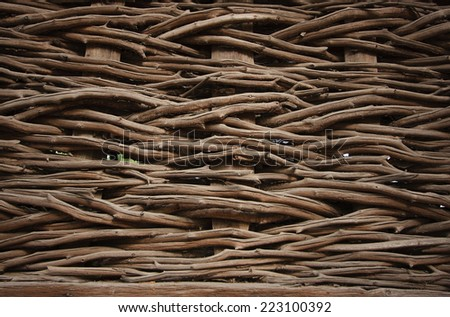 A woven willow wicker fence panel suitable for crafts, picnic or gardening background or wallpaper - stock photo