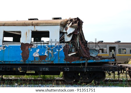 A wreckage of crashed or damaged train taken from train yard taken on sunny day, can be use for safety related communications - stock photo