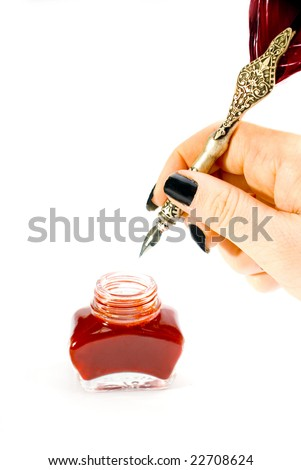 A writing feather with inkwell - stock photo