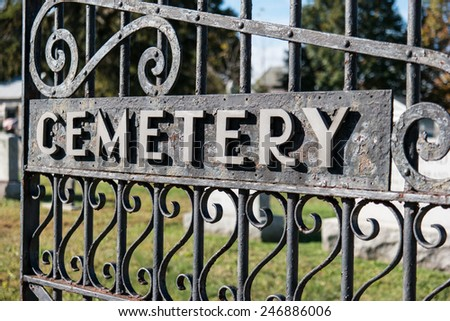 A wrought iron cemetery gate. - stock photo