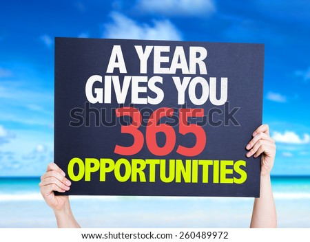 A Year Gives You 365 Opportunities card with beach background - stock photo
