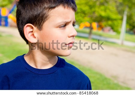 a 8 year old boy at the park - stock photo