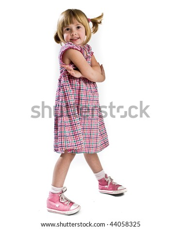 A 5 year old girl photographed in the studio. - stock photo