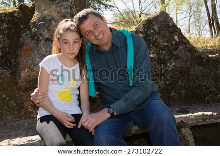 A 10 years old girl enjoying a moment of fun - stock photo