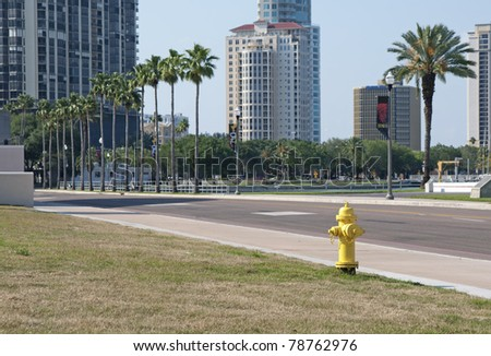A yellow fire hydrant on a St. Petersburg sidewalk - stock photo