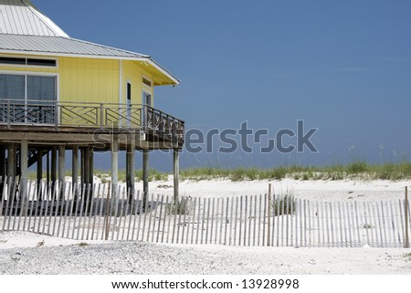A yellow home on the beach. - stock photo