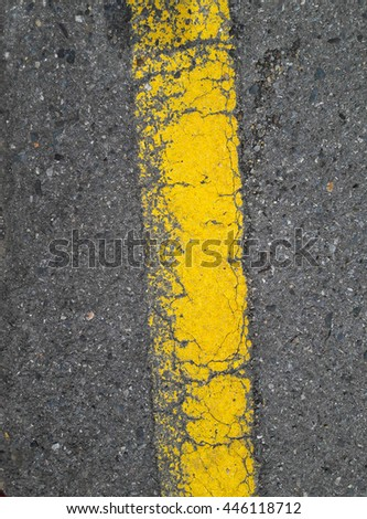 A Yellow Line On The Road - stock photo