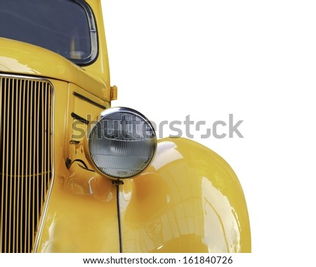 A yellow retro car headlight closeup isolated on white background.