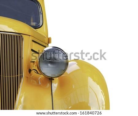 A yellow retro car headlight closeup isolated on white background. - stock photo