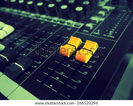 A yellow sound mixer buttons control with black and white  sound mixer buttons in vintage style. - stock photo