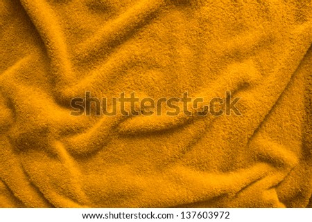 A yellow towel with Wrinkled