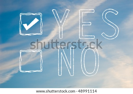 A yes or no tick box made out of white cloudy text against a blue sky. Yes is selected. - stock photo