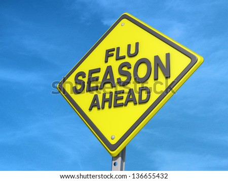 A yield road sign with Flu Season Ahead - stock photo