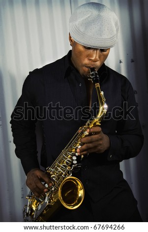 a young adult male saxophone musician