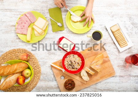 A young adult woman preparing a european style breakfast.  - stock photo