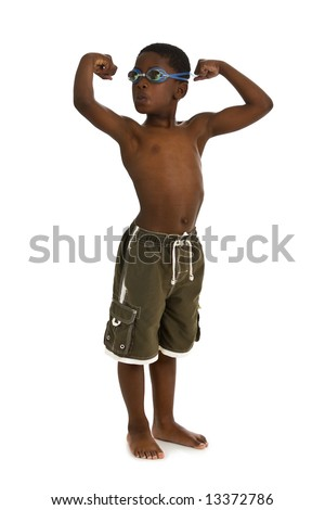 A young African American boy wearing swim trunks and goggles, and showing his muscles. Isolated on a white background. - stock photo