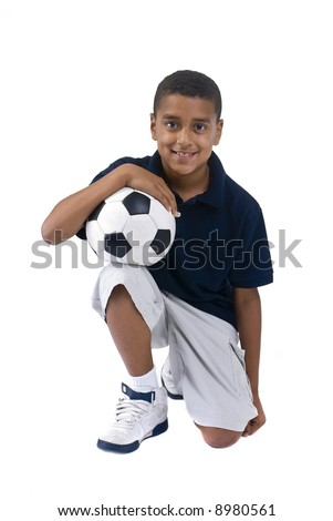A young african American boy with a soccer ball - stock photo