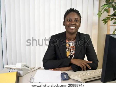 A young African American businesswoman with a big friendly smile. - stock photo