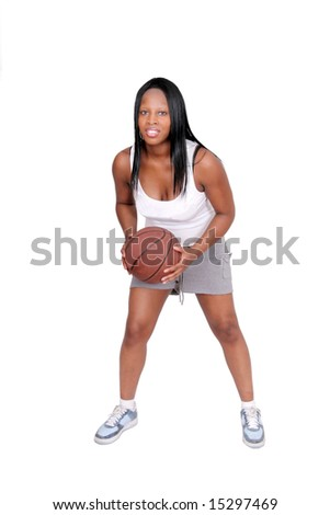 a young African American female playing basketball full length over white - stock photo