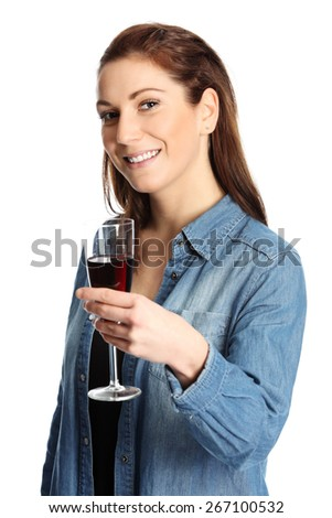 A young and attractive woman wearing a jeans shirt and holding a glass of red wine. White background. - stock photo