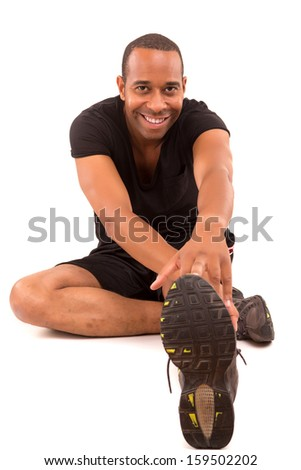 A young and handsome african fitness instructor - stock photo